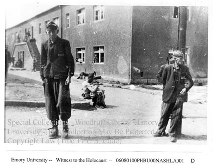 Survivors standing in front of building  [Buchenwald]