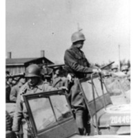 General Patton standing in his jeep addressing the assembled American troops  [Ohrdruf]