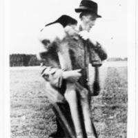 A German civilian carrying the corpse of a prisoner over his shoulder (1) [Landsberg]