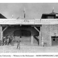 """The entrance to Mauthausen with a banner reading """"...Espanoles Antifacitas... Saludan a las Fuerzas Liberadoras..."""""""