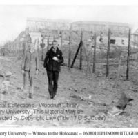Two men stand in front of building ruins  [Nordhausen]
