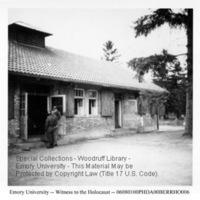 Liberators look in a crematorium at the Dachau concentration camp