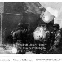Soldiers examine a building  [Buchenwald]