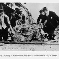 German civilians remove corpses of prisoners using stretchers (1 of 3)  [Nordhausen]