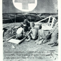 A group of survivors of Ebensee seated in a group next to one of the 30th Field Hospital tents