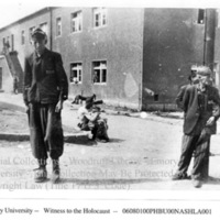 Survivors standing in front of building  [Buchenwald]