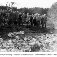 German civilians view corpses of prisoners under supervision of liberators  [Mauthausen]