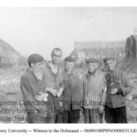 Five male survivors stand in front of building ruins  [Nordhausen]