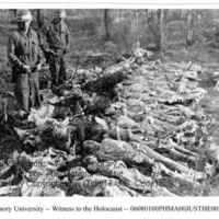 Two liberators view a row of corpses of female prisoners  [Mauthausen]